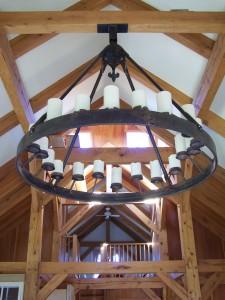 20 light electrified chandelier with fleur de lis escutcheon and round frame.